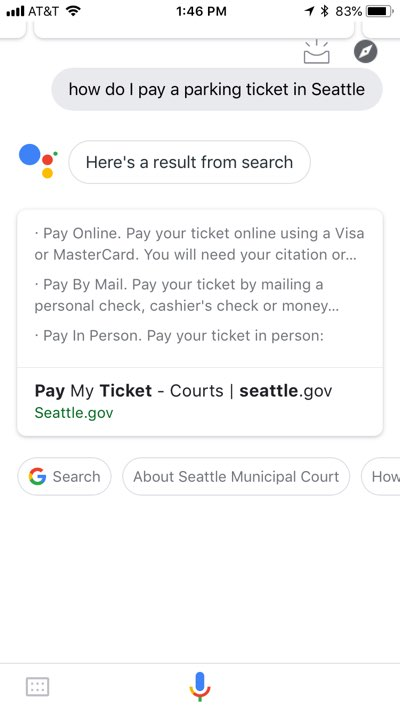 "Google Assistant app on iPhone with the results of a ""how do I pay a parking ticket in Seattle"" query, showing nearly the same results as on the desktop web page referenced above."